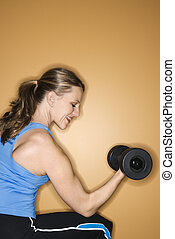 Woman lifting weights. - Prime adult female Caucasian...