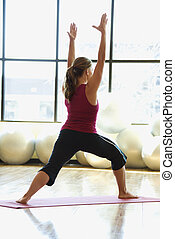 Woman doing woman - Caucasian prime adult female doing yoga...