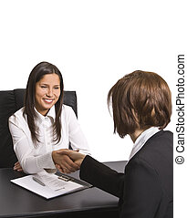 The deal - Businesswomen shaking hands in the officeThe...