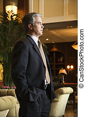 Businessman in hotel lobby - Caucasian prime adult male...