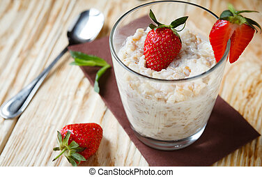 oatmeal with strawberries for breakfast, food close up