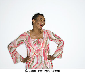 Woman with hands on hip. - African American mature adult...