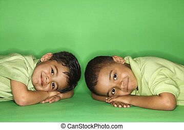 Boys looking at viewer - Hispanic and African American male...
