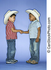 Boys in cowboy hats shaking hands. - Hispanic and African...