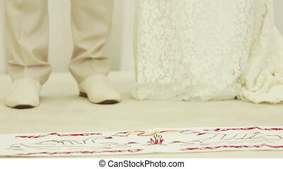 Wedding embroidered towel - The bride and groom stand on...