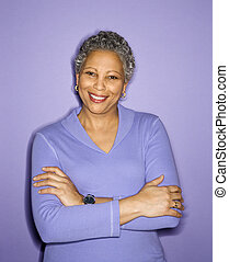 Portrait of smiling woman - African American mature adult...
