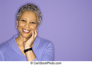 Portrait of woman smiling. - African American mature adult...