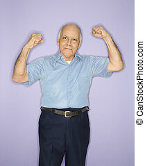Man flexing muscles. - Caucasian mature adult male flexing...