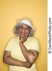 Woman looking at viewer smiling. - African American female...