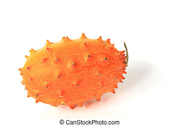 Horned melon (Cucumis metuliferus), isolated against a white...