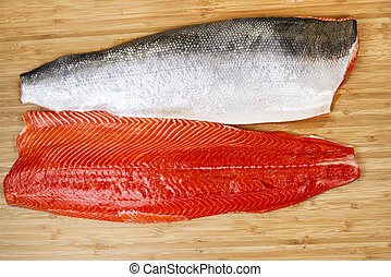 Fresh Red Salmon Fillets on Bambbo Board - Horizontal photo...
