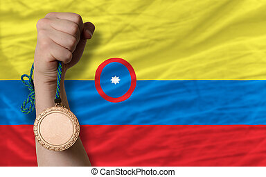 Bronze medal for sport and national flag of columbia -...