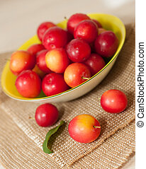 cherry-plums - the red cherry-plums on yellow plate