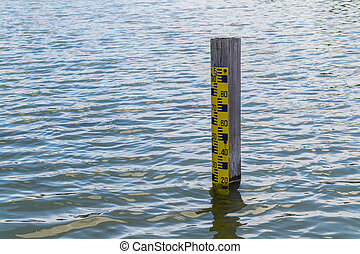 Water level pole in a pond