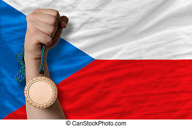 Bronze medal for sport and national flag of czech - Holding...