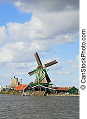 Cool windy day. Traditional windmills and economic...