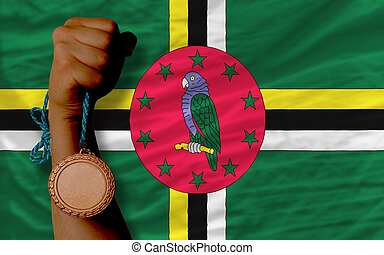Bronze medal for sport and national flag of dominica -...