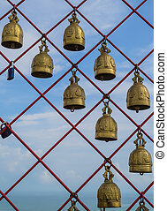 Holy bells - Many of holy bells are hanging on the red net...