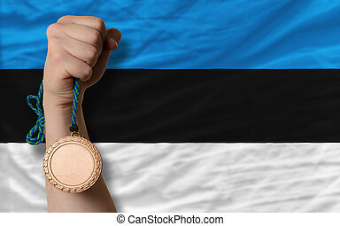 Bronze medal for sport and national flag of estonia -...