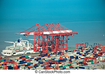 loading container ship - container terminal closeup,loading...
