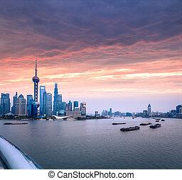 shanghai skyline with huangpu river at dusk - shanghai...