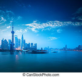 shanghai in dawn - shanghai skyline and huangpu river...