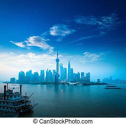 shanghai in daybreak - shanghai skyline and huangpu river in...