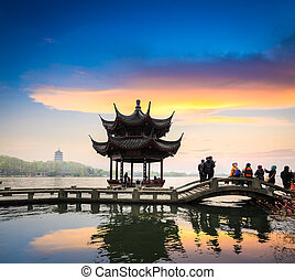 hangzhou in sunset - beautiful west lake scenery at dusk in...