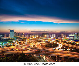 city overpass at nightfall - beautiful city interchange...