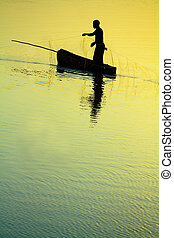 Traditional Fisherman Sillhouette - Dramatic sunset of a...