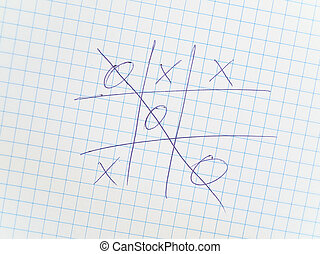 tic-tac-toe - Photo of the tic-tac-toe at chequered paper
