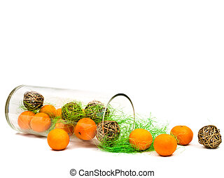 decorative glass vase with mandarines and golden balls...