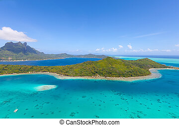 bora bora island from air - view from helicopter at mount...