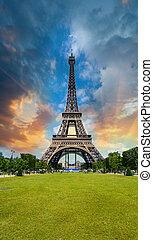 Sunset sky above Eiffel Tower - Paris. La Tour Eiffel from...