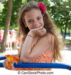 Smiling little girl on the playground