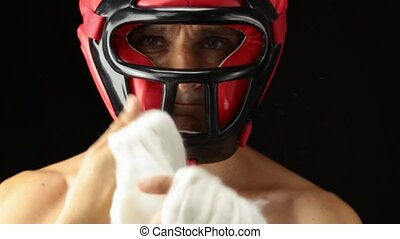 Wrapping Hands For Boxing - boxer over black background