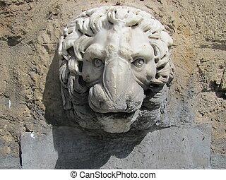 A lion head - A stone figure of a lion head