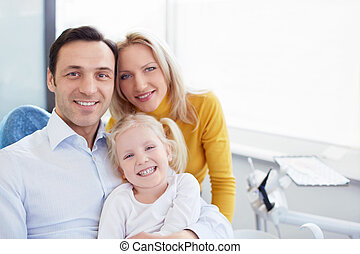 Medicine - Smiling family in a dental clinic