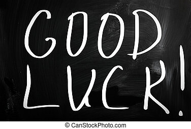 """Good luck!"" handwritten with white chalk on a blackboard"