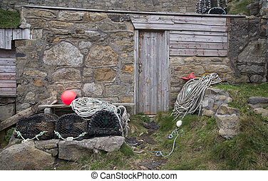 Fishing industry paraphenalia and huts at Cornish fishing...