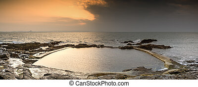 Sunrise at an ocean swimming pool in Spring on England's...