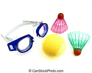 Swimming glasses tennis ball and shuttlecocks against the...