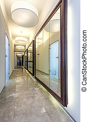 Corridor with mirrors - Long modern corridor with mirrors on...