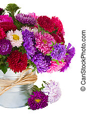 bouquet of aster flowers in metal pot - bouquet of red and...