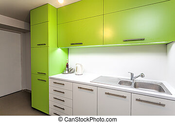 Green kitchen furniture - Green and white furniture in a...