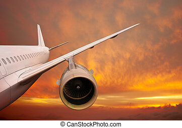 plane is flying at sunset airplane on a background of the...