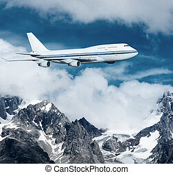 plane flying over the snow-capped mountains passenger...