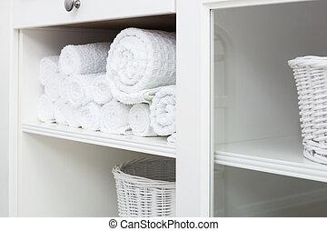 towel on a shelf - white towel on a shelf in the closet