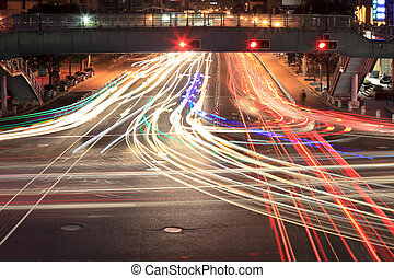 light traces on crossroad at night - light trails on...