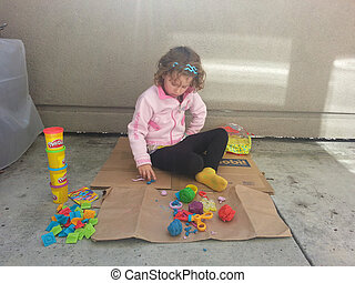 Playdough - Playing with playdough sitting on the ground...
